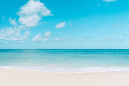 Beautiful tropical beach with blue sky and white clouds