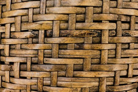 Interlaced brown rattan fibers background.