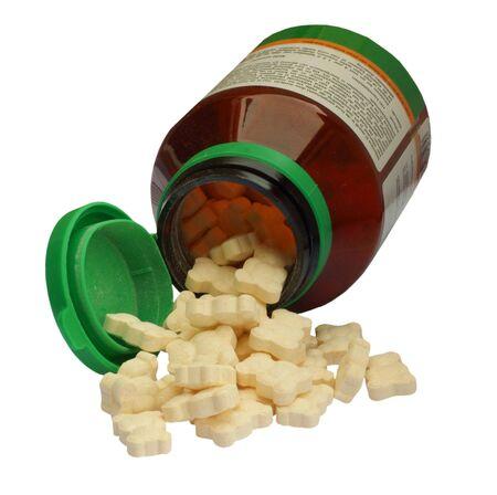 Vitamine pills for children, isolated on background