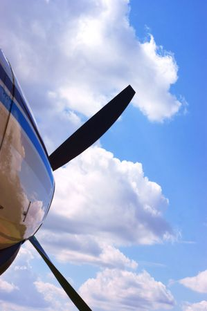 Propellor against a partially clouded sky