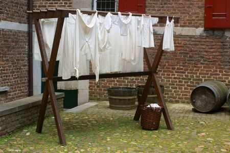 'dark ages': Drying laundry in the dark ages Stock Photo