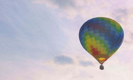 Hot air balloon in flight with a lot of blue sky
