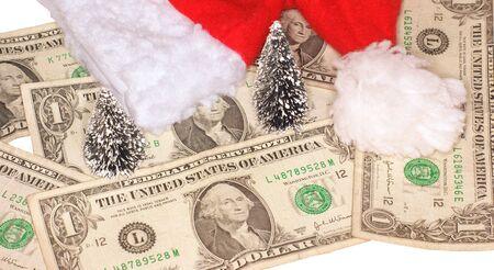 christmas budget: Dollars, christmas trees and santa hat