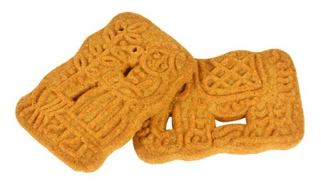 speculaas: Speculaas, a dutch cookie, isolated against background Stock Photo