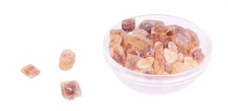 Glass bowl with candy sugar blocks, isolated against background Stock Photo - 8278711