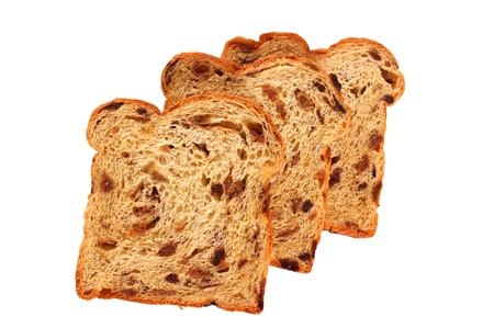 Slices of raisin bread, isolated against background Stock Photo - 8692305