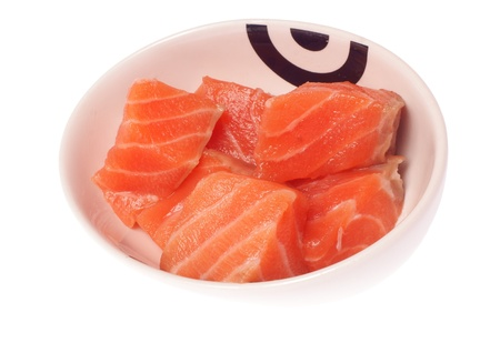 Small bowl with raw salmon, isolated against background Stock Photo