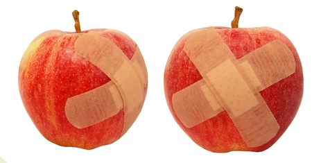 Wounded apples with a plaster