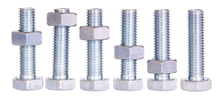 Bolt and nuts, position of nuts represents declining steel inductry Stock Photo
