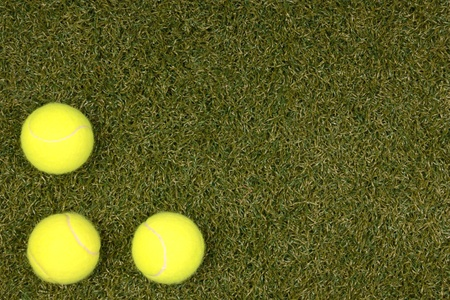 Tennis balls on artificial grass with room for text Stock Photo
