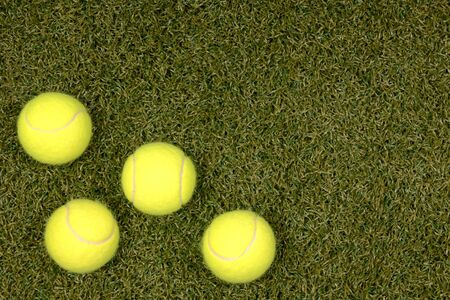Tennis balls on artificial grass background with room for text Stock Photo