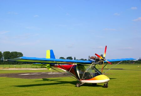 Small colorfull ultralight plane photo