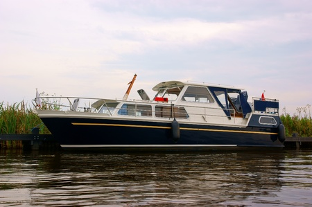 Typical dutch yacht (boat) floating in a river Stock Photo - 10267668