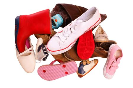 Pile of shoes, isolated against background photo