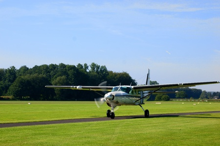 Small turboprop plane after landing Stock Photo