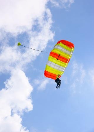 skydive: Tandem skydive parachute against a blue sky