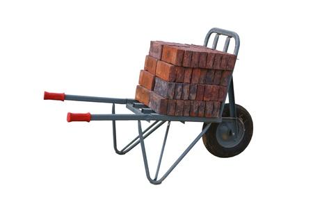 Wheelbarrow with bricks on a construction site, isolated on background