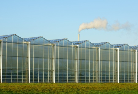 Glass greenhouse with greenhouse gas Stock Photo