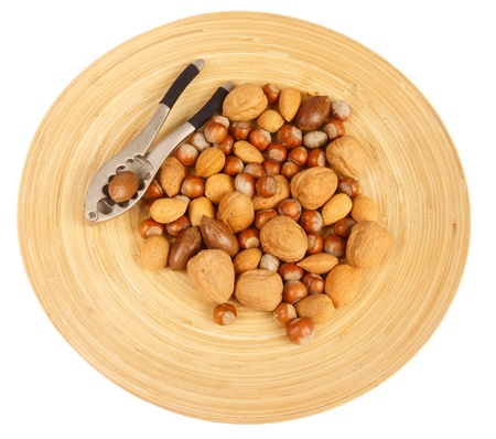 Bowl of nuts and nutcracker Stock Photo