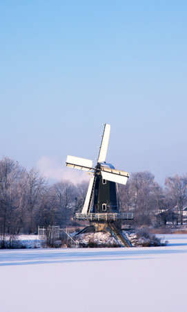 Dutch windmill in the snow photo