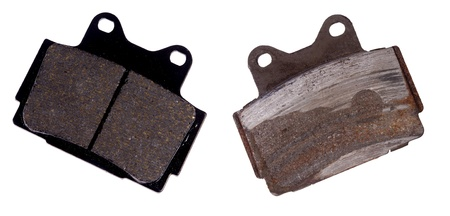 New and worn brake pad, isolated on background Banco de Imagens