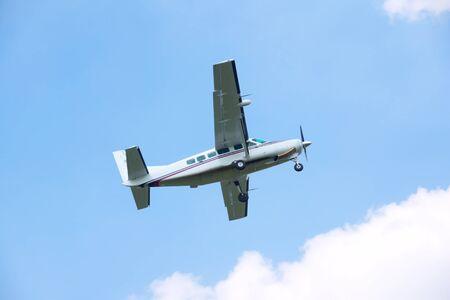 turboprop: Turboprop airplane taking off in blue sky