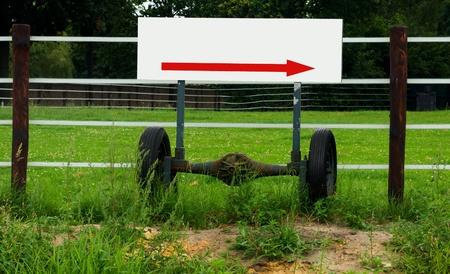 Empty arrow sign on wheel axle Stock Photo