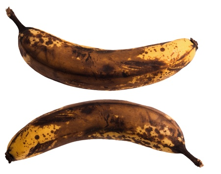 Old dark brown banana isolated on background photo