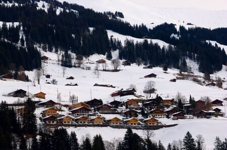 Houses in the snow in Switserland