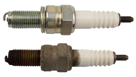 Used and new sparkplug, isolated against background Stock Photo