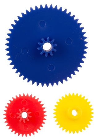 Plastic gearing wheels, isolated against background