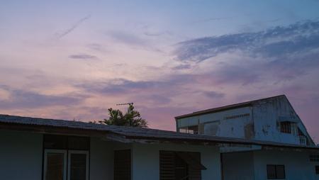 suburban neighborhood: Sunset behind houses