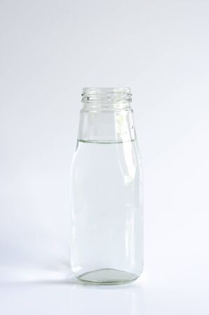 Water in a glass bottle isolated