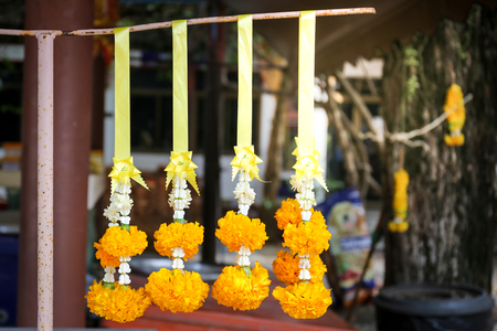 Four wreaths worship the Buddha.Marigold flowers hanging for sale.