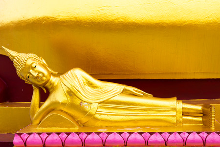 Ancient golden reclining buddha at Big Buddha Temple is a famous tourist destination of Koh Samui island, Surat Thani province, Thailand Reklamní fotografie