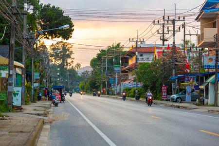 Suratthani, Thailand - November 30, 2018: Motorcyclists drive around on the road around Koh Samui Southern Thailand in evening on the November 30, 2018 in Samui Island, Suratthani, Thailand. Editorial