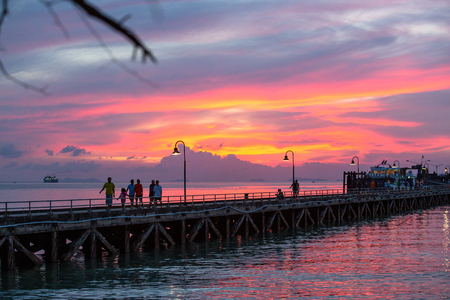Suratthani, Thailand - November 15, 2018: People are exercising on the bridge, the harbor, the evening, the bright sky, and many fishing boats on the November 15, 2018 in Samui Island, Suratthani, Thailand. Editorial