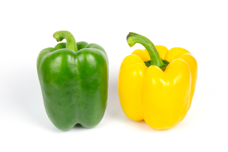 Two bell peppers on white background. Banco de Imagens