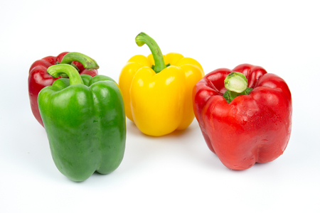 Four bell peppers on white background. Banco de Imagens