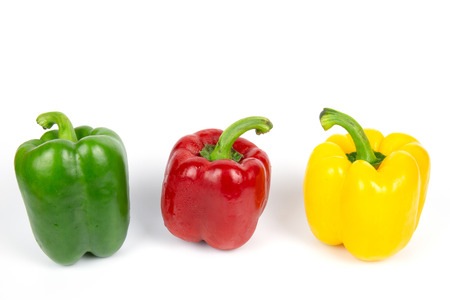 Three bell peppers on white background.