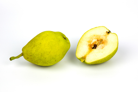 Fresh pears, one and a half yellow fruit on white background Banco de Imagens