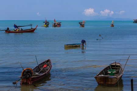 Many fishing boats park in the sea in Samui Island, Suratthani, Thailand.