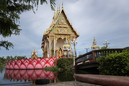 The Thai temple in Wat Plai Laem in Samui Island Thailand, in the middle of the water, contains giant statues and elephants. Banco de Imagens