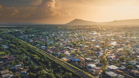 Aerial Photo View Big City Near Mountain a railway cut through The City. 写真素材