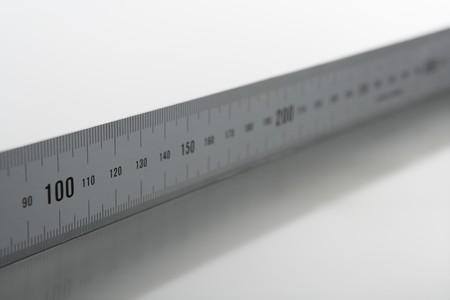 micrometer: Silver aluminium metal, ruler meter on stainless steel studio backg