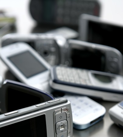 Assorted mixed mobile phones, old, new technology in cell\ telephones