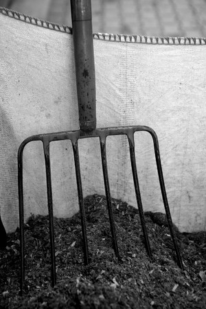 Horse stable witth straw fork tool, sawdust. Stock Photo - 4040827