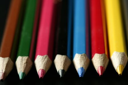 Colorful set of pen in vibrant colors over black background photo