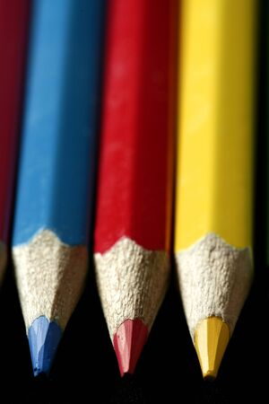 Colorful set three pen in vibrant colors over black background photo