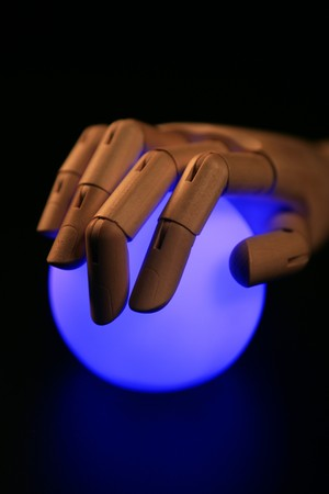 Wooden mannequin hand, ball of light, fortune teller, adivination photo